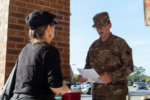 Photo of an Airman evaluating a commissary customer.