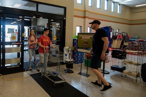 Photo of customers walking into the commissary after a health screening.