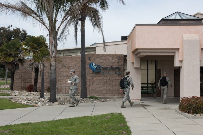 Photo of airmen walking to and from dining facility.