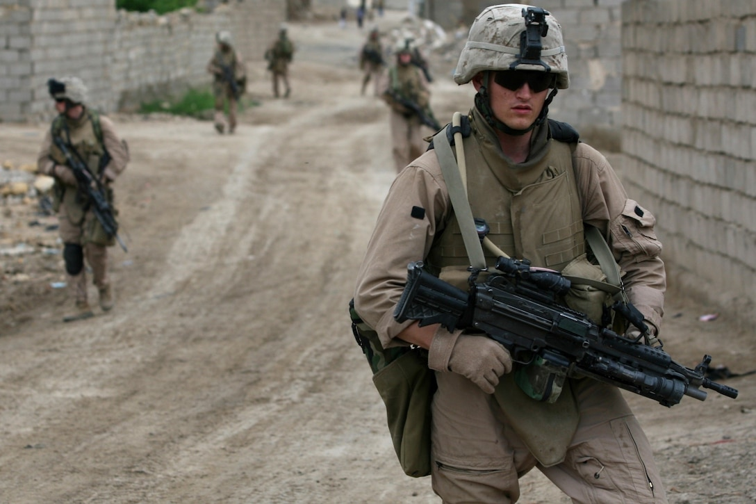 SAQLAWIYAH, Iraq - Marines with 2nd squad, 2nd platoon return to forward operating base Riviera after a patrol on April 28, 2007. The Marines of Fox Company, 2nd Battalion, 7th Marine Regiment conduct security patrols to monitor and prevent possible anti-coalition force attacks. Regimental Combat Team 6 is deployed with Multi National Forces-West in support of Operation Iraqi Freedom in the Al Anbar province of Iraq to develop Iraqi Security Forces, facilitate the development of official rule of law through democratic reforms, and continue the development of a market based economy centered on Iraqi reconstruction. (U.S. Marine Corps photo by Cpl. Neill A. Sevelius) (Released)