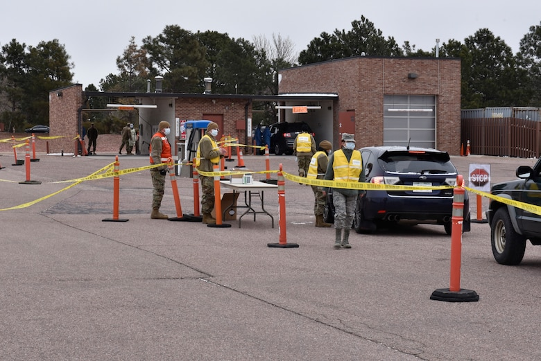 Medical professionals at Peterson Air Force Base, Colorado, established a COVID-19 test location at the car wash to help limit the possible spread of the virus, March 20, 2020. The consolidation of patients to this area will help minimize the exposure to COVID-19. The center is open by appointment only. (Air Force photo by Airman 1st Class Alexis Christian)