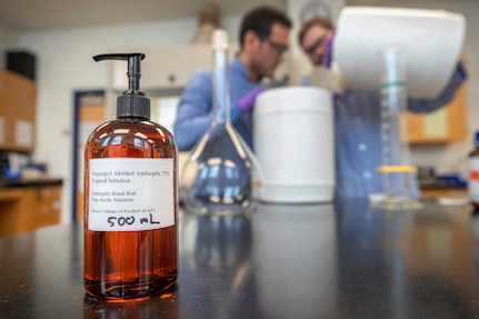 Code 134, Laboratory Division, chemists Anthony Painter and Deniz Ferrin made hand sanitizer March 20, 2020, inside the Puget Sound Naval Shipyard & Intermediate Maintenance Facility chem lab in Building 59, for use throughout the shipyard. (PSNS & IMF photo by Scott Hansen)