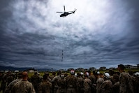 U.S. Service members from across Hawaii conduct special-patrol insertion and extraction rigging drills under the instruction of helicopter rope suspension techniques instructors with expeditionary operations training group, III Marine Expeditionary Force at Landing Zone Eagle, Marine Corps Base Hawaii, Mar. 19, 2020. SPIE rigging and rappelling techniques are used to rapidly insert and extract Marines when a landing zone is unavailable. (U.S. Marine Corps photo by Sgt. Alex Kouns)