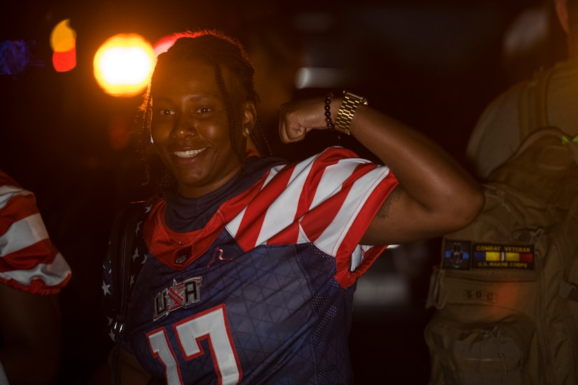 A member of the U.S. women's football team poses after her flight at Joint Base Charleston, S.C., March 20, 2020.