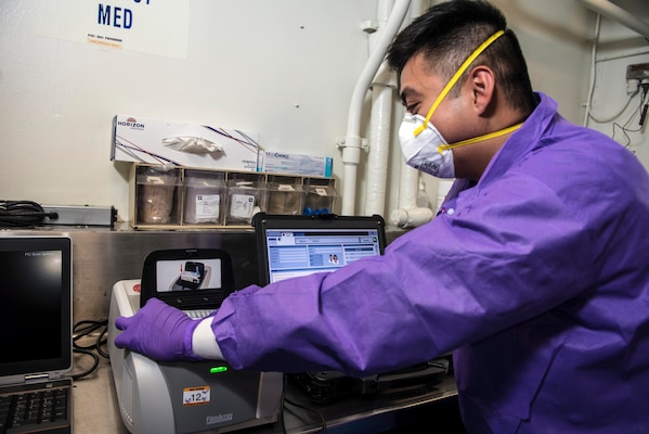 SOUTH CHINA SEA – (March 14, 2020) Hospital Corpsman Gian Molina, assigned to Navy Environmental Preventative Medicine Unit Six, tests samples in a BioFire Film Array, which will test for nearly 30 different diseases, aboard the U.S. 7th Fleet flagship USS Blue Ridge (LCC 19). To date, no cases of COVID-19 have been detected aboard any 7th Fleet U.S. Navy vessels, but if a case were to arise, ships have isolation plans in place to contain the infection. As the U.S. Navy's largest forward-deployed fleet, 7th Fleet operates roughly 50-70 ships and submarines and 140 aircraft with approximately 20,000 Sailors.