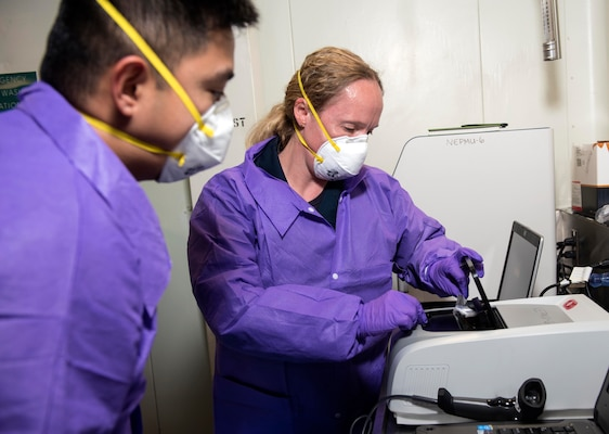 SOUTH CHINA SEA – (March 14, 2020) Members of the Navy's preventative medicine team Lt. Cmdr. Rebecca Pavlicek, and Hospital Corpsman Gian Molina, both assigned to Navy Environmental Preventative Medicine Unit Six, test samples in a BioFire Film Array, which will test for nearly 30 different diseases, aboard the U.S. 7th Fleet flagship USS Blue Ridge (LCC 19). To date, no cases of COVID-19 have been detected aboard any 7th Fleet U.S. Navy vessels, but if a case were to arise, ships have isolation plans in place to contain the infection. As the U.S. Navy's largest forward-deployed fleet, 7th Fleet operates roughly 50-70 ships and submarines and 140 aircraft with approximately 20,000 Sailors.