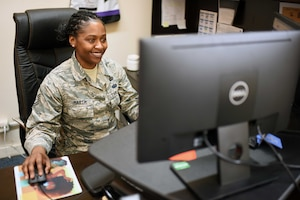 U.S. Air Force Master Sgt. Ashley Martin, 39th Air Base Wing Equal Opportunity director, works at her desk, March 11, 2020, at Incirlik Air Base, Turkey. During her 13 years of service, Martin gives back to fellow Airmen by ensuring organizations conduct their affairs free from unlawful discrimination and sexual harassment. (U.S. Air Force photo by Tech. Sgt. Jim Araos)