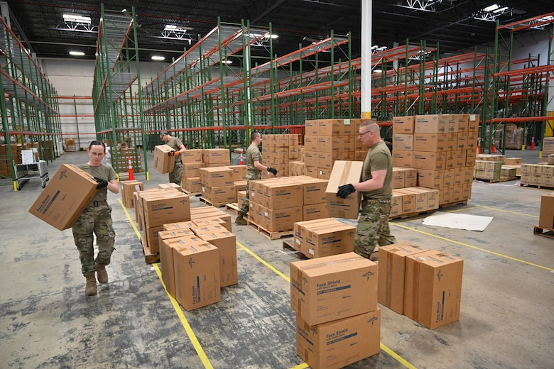 Members of the Maryland Air National Guard 175th Logistics Readiness Squadron work with members of the Maryland Office of Preparedness and Response March 19, 2020, to prepare and load medical supplies and equipment at the Maryland Strategic National Stockpile. All assets provided were prioritized for health care workers and hospitals in response to the COVID-19 pandemic.
