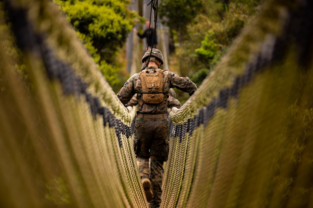 U.S. Marines cross a rope bridge during the endurance course at the Jungle Warfare Training Center in Okinawa, Japan, March 20.