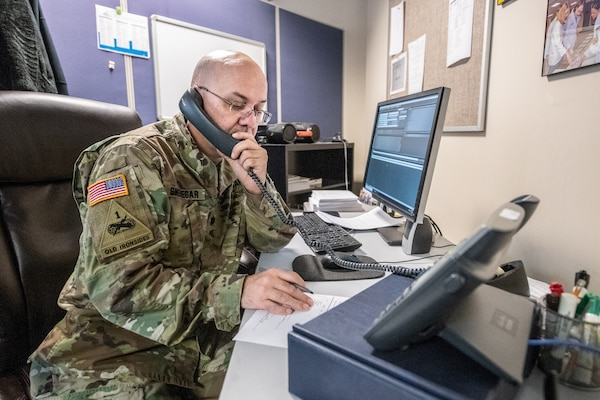 Lt. Col. John Snedegar, Medical training Officer, Medical Detachment, West Virginia National Guard (WVNG), assists state partner agencies by manning phone lines at the West Virginia Poison Center, part of the statewide Coronavirus 2019/COVID-19 response efforts, March 19, 2020, in Charleston, West Virginia. The members are answering questions and inquiries from concerned citizens on a hotline established as part of an interagency whole-of-government approach in response to the ongoing pandemic. (U.S. Army National Guard video by Edwin L. Wriston)