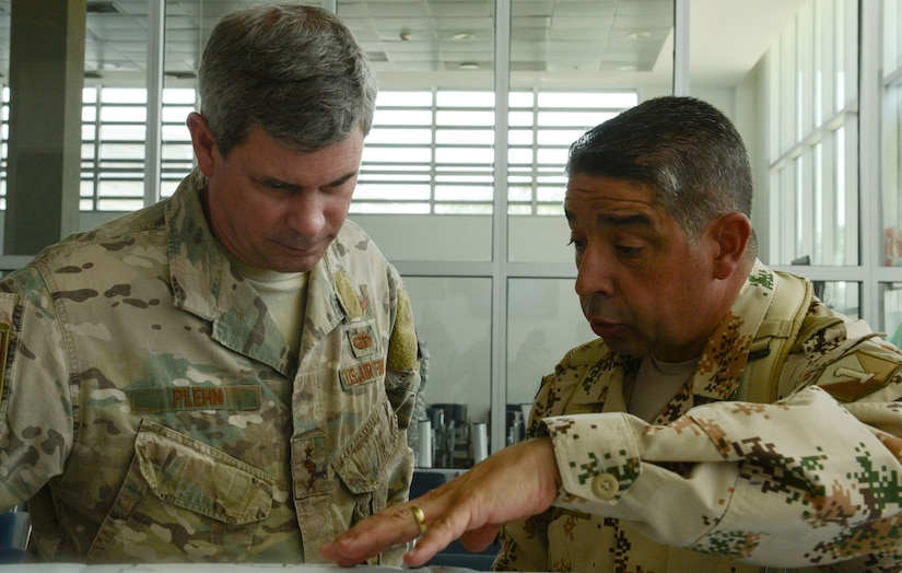 Colombian Army Maj. Gen. Hugo Lopez Barreto, right, senior commander for Exercise Vita, discusses exercise operations and events with U.S. Air Force Lt. Gen. Michael Plehn, military deputy commander of U.S. Souther Command, ahead of a visit to a medical readiness training event as part of Exercise Vita in Riohacha, Colombia, March 13, 2020. Exercise Vita is a combined event that brought U.S. and Colombian forces together to perform humanitarian and civic-action operations. The exercise focused on reinforcing longstanding ties and enhancing participants' overall readiness while demonstrating U.S. Southern Command's enduring promise to the Americas. (U.S. Air Force photo by Capt. Beau Downey)