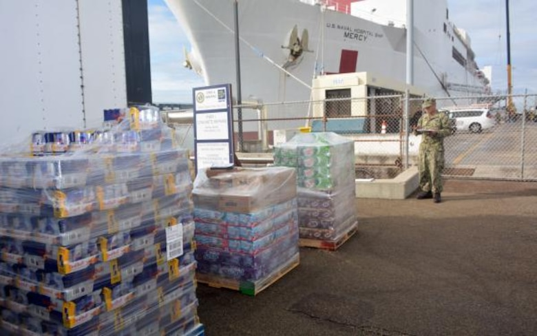 Pallets of supplies await to be craned aboard Military Sealift Command hospital ship USNS Mercy (T-AH 19) at Naval Base San Diego, March 21. Huntsville Center is providing an $187,000 information technology software acquisition for the Mercy as the ship serves as a referral hospital for non-COVID-19 patients currently admitted to shore-based hospitals.