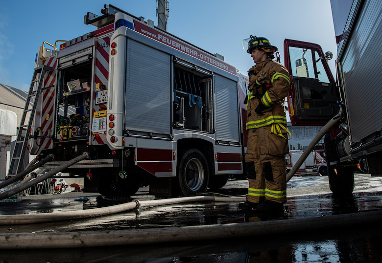 U.S. Air Force Airman 1st Class Jackson Bird, 86th Civil Engineer Squadron Fire and Emergencies firefighter, supervises the transfer of water from Ramstein Air Base's fire truck to the German fire truck in Otterberg, Germany, March 23, 2020.