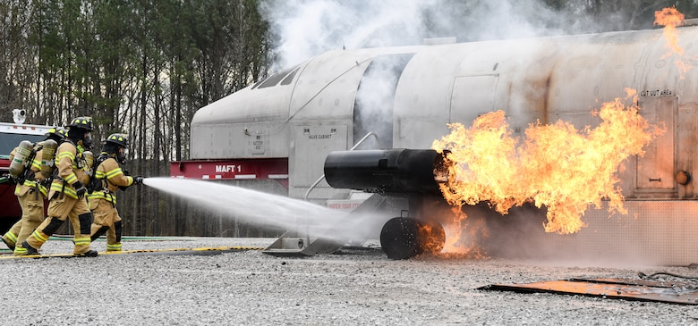 Arnold Air Force Base Fire and Emergency Services personnel attack an aircraft fire with a hand line as they train, March 5, 2020, on aircraft rescue and firefighting techniques using a propane-fueled trainer brought to the base. The aircraft trainer can simulate fires in multiple locations - cabin, ground, engine, wheel and brake, and the auxiliary power unit. (U.S. Air Force photo by Jill Pickett)