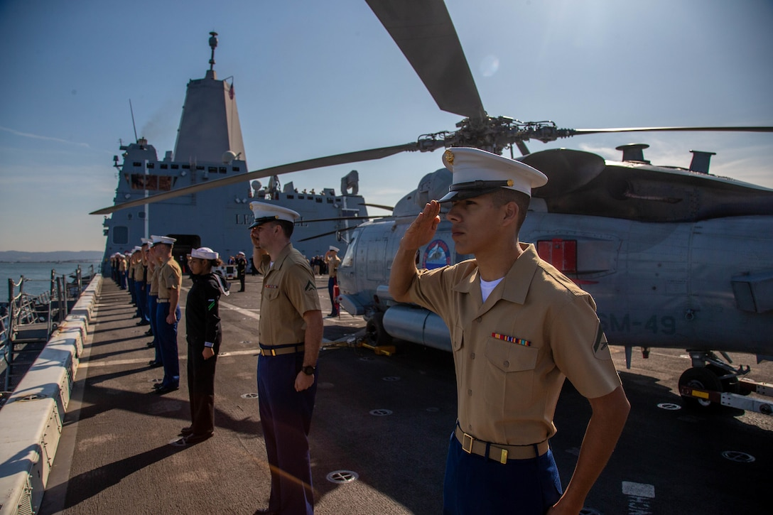 U.S. Marines and Sailors salute as they man the rails of the USS Somerset (LPD-25) during San Francisco Fleet Week's Parade of Ships on Oct. 11.