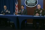 "Defense Secretary Dr. Mark T. Esper, center; Army Gen. Mark A. Milley, chairman of the Joint Chiefs of Staff, right; and Senior Enlisted Advisor to the Chairman Ramón ""CZ"" Colón-López hold a virtual town hall meeting at the Pentagon to answer questions on the department's COVID-19 response, March 24, 2020."