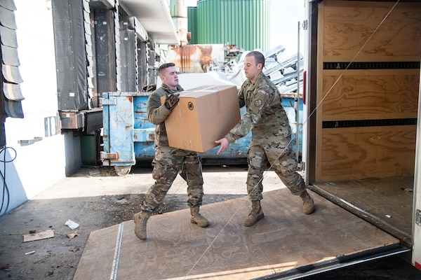 Members of the West Virginia National Guard assist state-level partner agencies, including the West Virginia Department of Health and Human Resources and West Virginia Division of Homeland Security and Emergency Management, with the logistical movement and delivery of in-demand medical supplies to hospitals, clinics, and local departments of health throughout West Virginia in support of COVID-19 pandemic outbreak response efforts, March 24, 2020, in Poca, West Virginia. Workers packaged up large distributions of supplies such as surgical masks, respirators, sterile gowns, and examination gloves which were then loaded into vehicles for rapid dispatch and delivery around the state. (U.S. Army National Guard photo by Edwin L. Wriston)