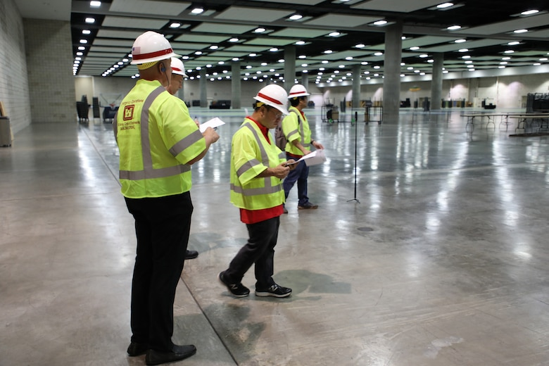 As part of a local U.S. Army Corps of Engineers (USACE) response to the spread of coronavirus in Honolulu, a five-man USACE technical survey team conducted a site assessment of the 204,000 square foot exhibition hall at the Honolulu Convention Center on March 23, 2020.