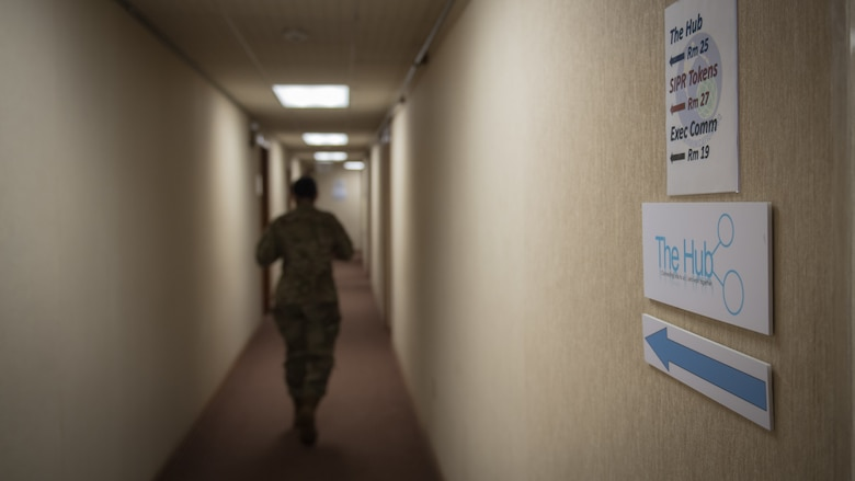 Tech. Sgt. Jessica Oliver, 2nd Communications Squadron base equipment control office NCO-in-charge, walks through the down a hallway at the 2nd CS on Barksdale Air Force Base, La., March 20, 2020. Oliver manages all IT hardware and software across the base. (U.S. Air Force photo by Tech. Sgt. Daniel Martinez)