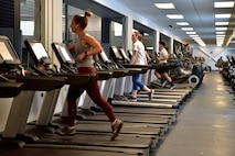 Airmen assigned to the 354th Fighter Wing run on treadmills in the Baker Fieldhouse on Eielson Air Force Base, Alaska, March 21, 2020. In light of the Department of Defense policy prohibiting group physical training the wing is enforcing social distancing at the gym by limiting the number of work out machines available for use. (U.S. Air Force photo by Senior Airman Beaux Hebert)