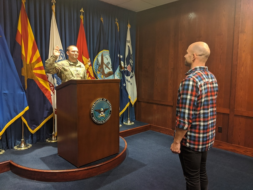 SAN DIEGO – Huntington Beach Recruiting Company Commander Capt. Jake Taeckens, podium, swears in his brother, Josh on March 19, 2020 at the San Diego Military Entrance and Processing Facility, while maintaining safe social distance. The Taeckens' became brothers-in-arms during one of the final days of San Diego MEPS operations, prior to U.S. Army Recruiters switching to all-online recruiting efforts. For more information on Army Careers available during the COVID-19 outbreak, text: ALA0 to GOARMY (462769).