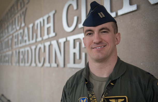 "Air Force Capt. (Dr.) Joseph Sharp, a 509th Medical Group flight surgeon, stands in front of the clinic at Whiteman Air Force Base, Missouri, March 1, 2020. Sharp earned the Air Force Global Strike Command ""Flight Surgeon of the Year Award"" for his innovative practices and dedication to his patients. (U.S. Air Force Photo by Airman 1st Class Thomas Johns)"