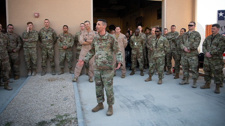 U.S. Air Force Chief Master Sgt. Shawn Drinkard, U.S. Air Forces Central Command command chief, speaks with AFCENT Airmen outside of the combined air operations center at Al Udeid Air Base, Qatar, March 6, 2020.