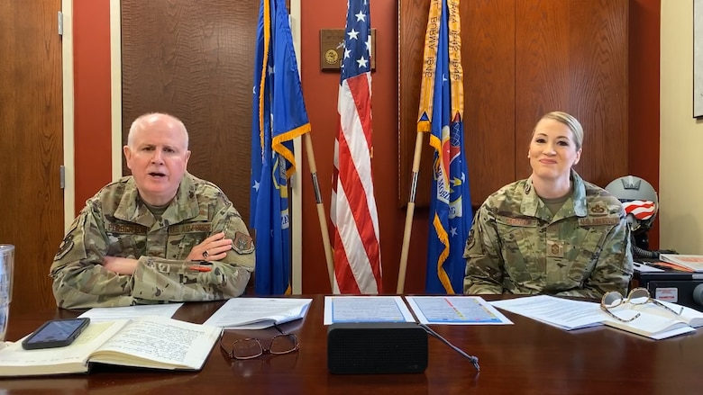 Col. Thomas Pemberton, 514th Air Mobility Wing commander, and Chief Master Sgt. Dana Capaldi, 514th AMW command chief, conduct a Facebook Live event during the wing's March virtual unit training assembly.