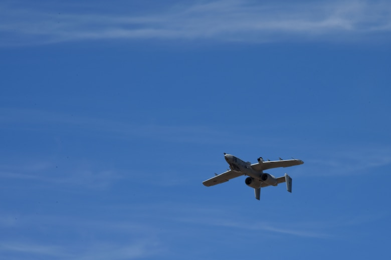 A photo of a plane flying over DM