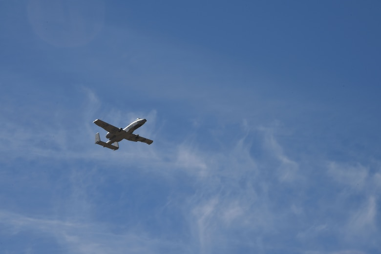 A photo of an A-10 flying over DM
