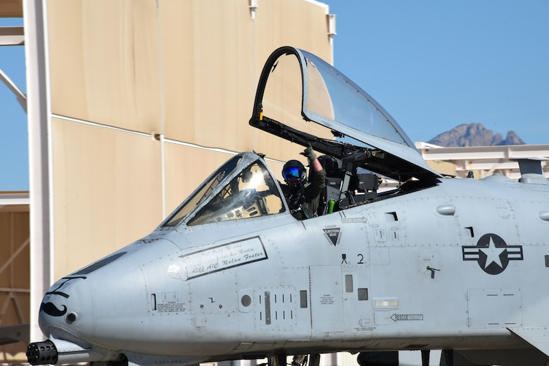 An A-10 sits on the flight line