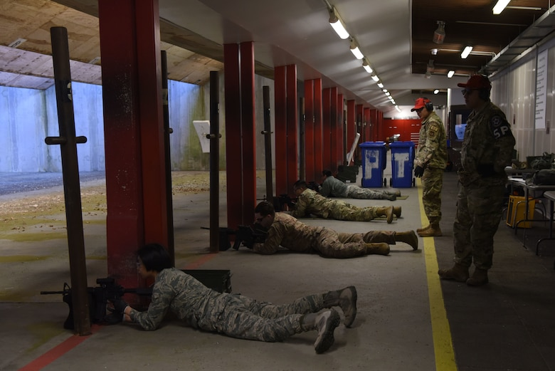 U.S. Airmen lay prone on a shooting range during a Combat Arms Training and Maintenance course.