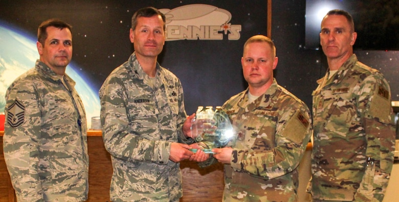 The 50th Security Forces Squadron earned the outstanding medium SFS award March 12, 2020 at Schriever Air Force Base, Colorado during an award ceremony at Bennie's. One of the several achievements by the 50th SFS included increasing engagement for the 50th Network Operations Group. From left are Senior Master Sgt. Jason Spedding, 50th Security Forces Squadron operations manager, Col. Gregory Anderson, United States Space Force SFS division chief, Maj. Adam Morgan, 50th SFS commander and Chief Master Sgt. Russell Louk, USSF SFS manager. (U.S. Air Force photo by Marcus Hill)