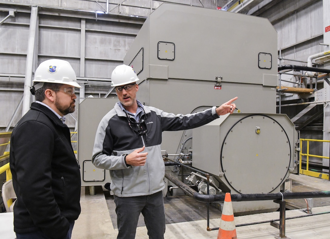 Joseph Baxter, right, an AEDC project manager, talks about A Plant Exhauster Motors improvements being completed under the Service Life Extension Program (SLEP), seen here Feb. 13, 2020, at Arnold Air Force Base, Tenn. Also pictured, Nathan Harrison, former SLEP manager for the Capital Improvements Branch. (U.S. Air Force photo by Jill Pickett)