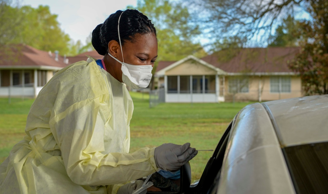 Image of healthcare provider doing drive-by screening