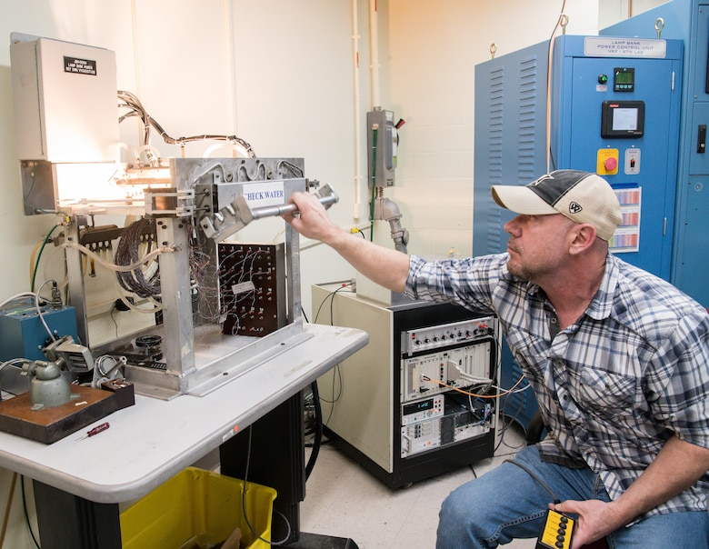 Brian Anderson, an instrumentation specialist, demonstrates the use of a machine to calibrate Schmidt-Boelter heat flux gauges Jan. 15, 2020, in the Aerothermal Calibration Laboratory at Arnold Air Force Base, Tenn. (U.S. Air Force photo by Jill Pickett)