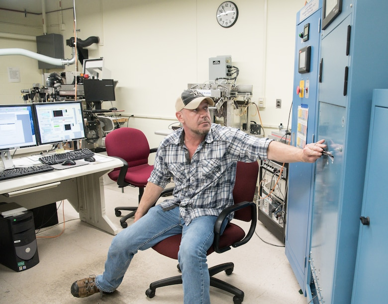 Brian Anderson, an instrumentation specialist, operates the Arc Lamp System in the Aerothermal Calibration Laboratory Jan. 15, 2020, while demonstrating the use of the machine to provide heat to a test cone for use at Arnold Air Force Base, Tenn. (U.S. Air Force photo by Jill Pickett)