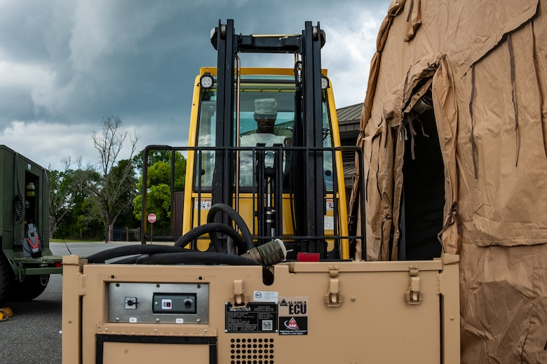 A photo of an Airman operating forklift.