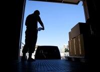 An Airmen prepares to unload boxes.