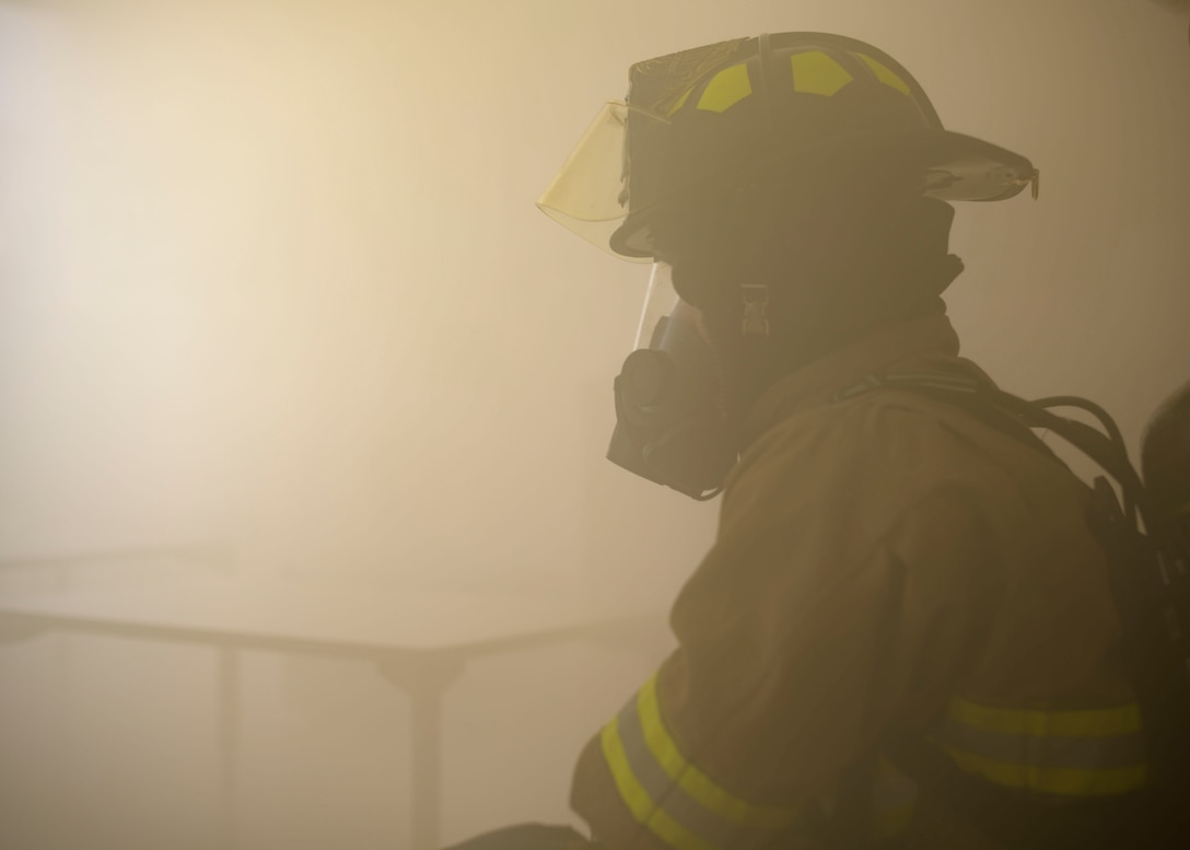 A fireman from the 366th Civil Engineer Squadron, participates in a training exercise, march 20, 2020, at Mountain Home Air Force Base. This training was conucted and designed to enhance readiness in response to emergency. (U.S. Air Force photo by Senior Airman Tyrell Hall)