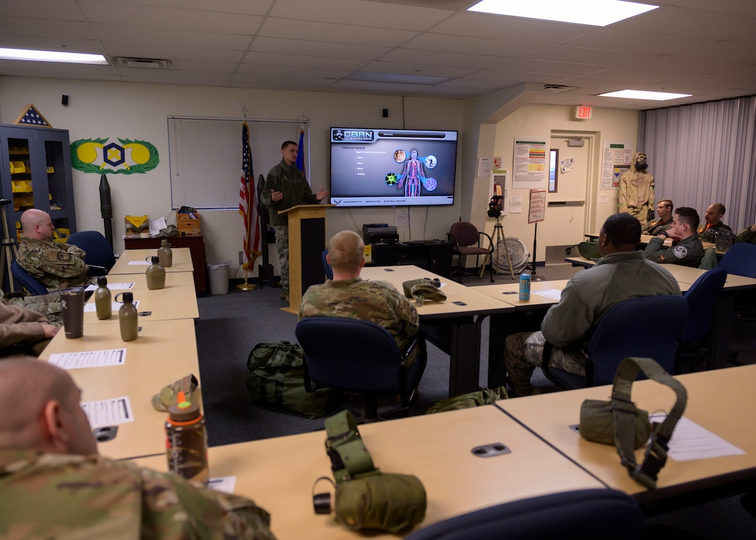 Airman 1st Class Nathan McMaster, 366th Civil Enginer Squadron emergency management technician, teaches a class on chemical, biological, radiological and nuclear defense (CBRN), March 20, 2020, at Mountain Home Air Force Base, Idhao. Airmen learn about CBRN as a part of required combat skills training, increasing their readiness. (U.S. Air Force photo by Senior Airman Tyrell Hall)