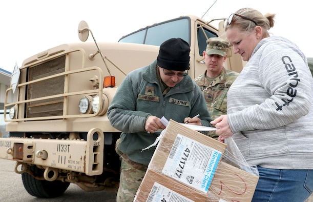 Sgt. Timothy Hesse Sr. and Sgt. Zachary Anderson, motor transport operators with the 1133rd Transportation Company, Iowa Army National Guard, deliver essential medical supplies in Iowa