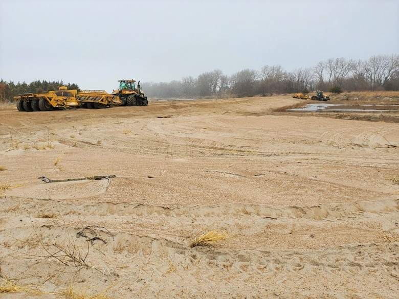 U.S. Army Corps of Engineers, Omaha District places sand to design elevation on Ames Diking in Ames, Neb., Mar. 25, 2020.