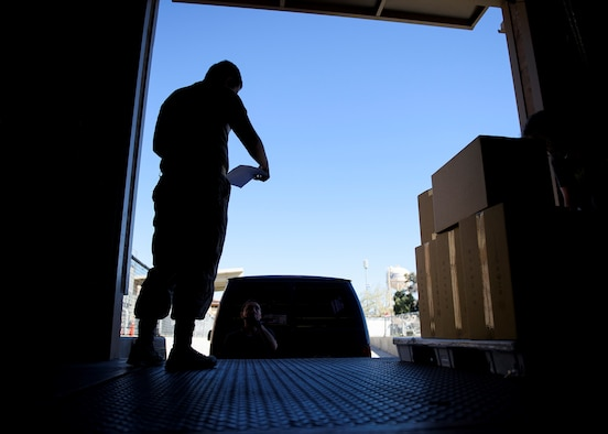 An Airmen prepares to unload boxes.