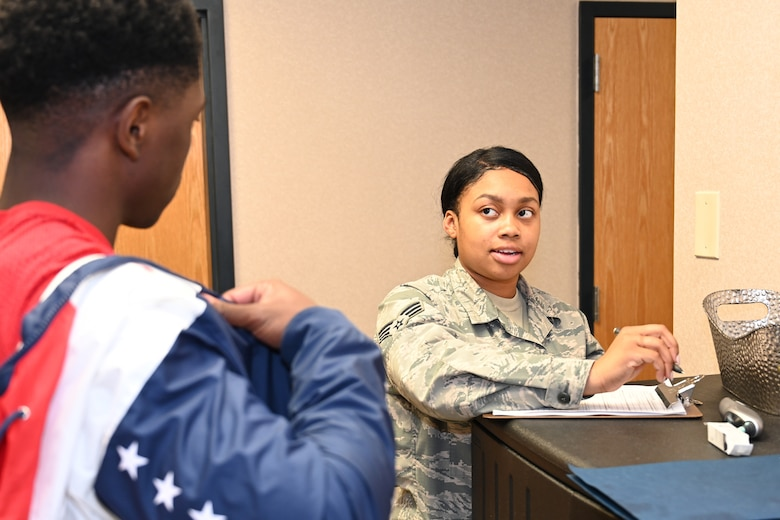 Photo of Airman administering screening.