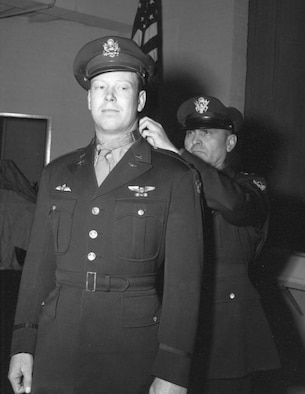 U.S. Air Force Lt. Gen. Ira Eaker, Eighth Air Force commander, presents the Medal of Honor to 1st Lt. John C. Morgan Dec. 17, 1943. (Courtesy photo)