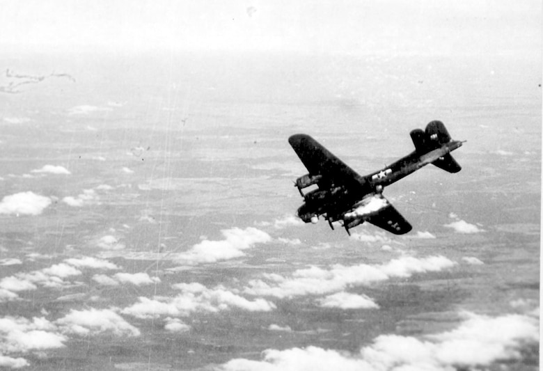 """A B-17 Flying Fortress nicknamed """"Chopstick - G. George"""" of the 482nd Bomb Group goes down in flames over Berlin after being hit by flak in the right fuel tanks,  March 6, 1944. U.S. Army Air Forces Capt. John C. Morgan, 482nd BG B-17 pilot, was taken as a Prisoner of War (POW) and held in Stalag Luft I for 14 months. (Courtesy photo)"""