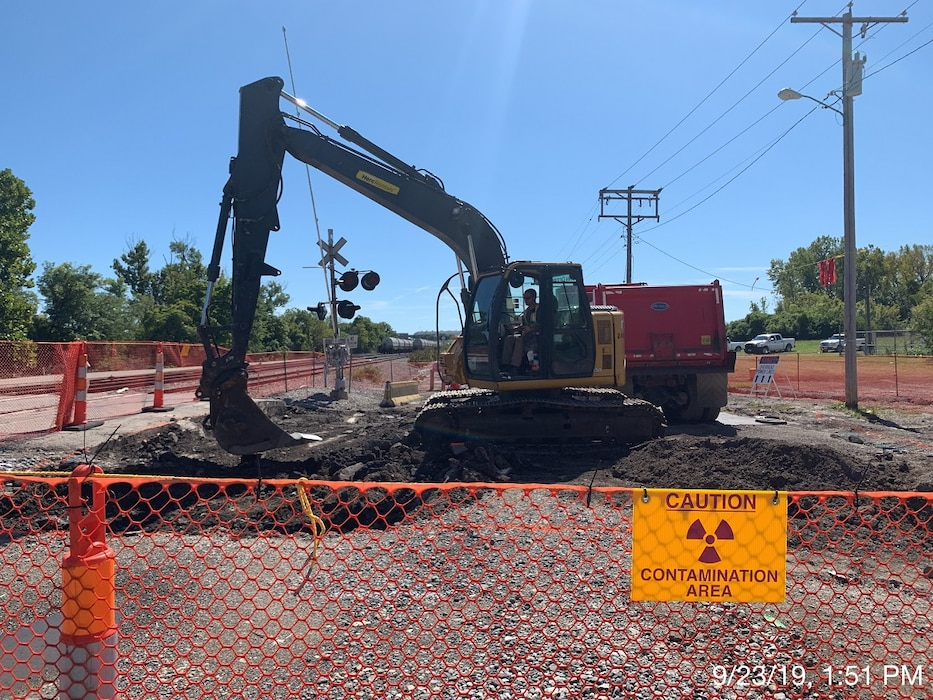 A contractor for the U.S. Army Corps of Engineers St. Louis District's Formerly Utilized Sites Remedial Action Program (FUSRAP) operates an excavator to conduct remediation on Eva Avenue in Hazelwood, Missouri, during utility support for roadwork in North St. Louis County Monday, Sept. 23, 2019.