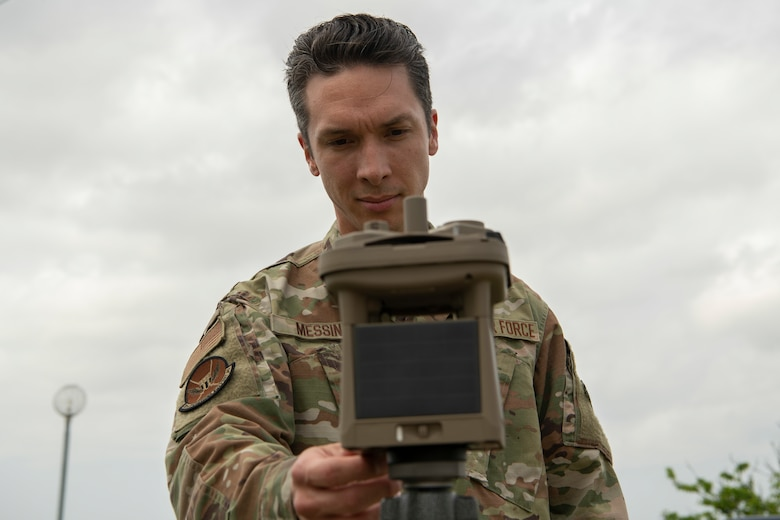 Senior Airman Thomas Messina, 18th Operations Support Squadron weather journeyman, inspects a micro weather sensor Mar. 26, 2020, at Kadena Air Base, Japan. Messina took measurements after a shift change ensuring his information was up-to-date for continued flight operations at Kadena AB. (U.S. Air Force photo by Senior Airman Rhett Isbell)
