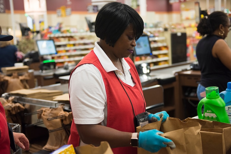 Shirley Burgohy, a head bagger at the Air Base Commissary, bags groceries at Joint Base Charleston S.C., March 24, 2020.